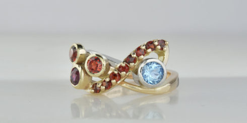 Remodelled gold and platinum ring with garnets & aquamarine.